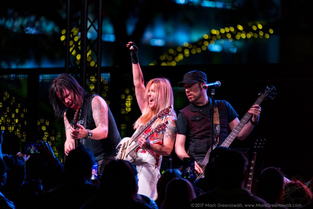 Patrick Kennison (Lead Guitarist), Lita Ford (Vocalist, Guitarist), & Marty O'Brien (Bassist) - Photo Credit: Mark Greenawalt